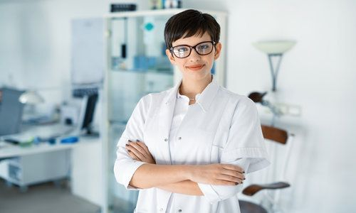 Portrait of female optometrist at eyesight medical clinic
